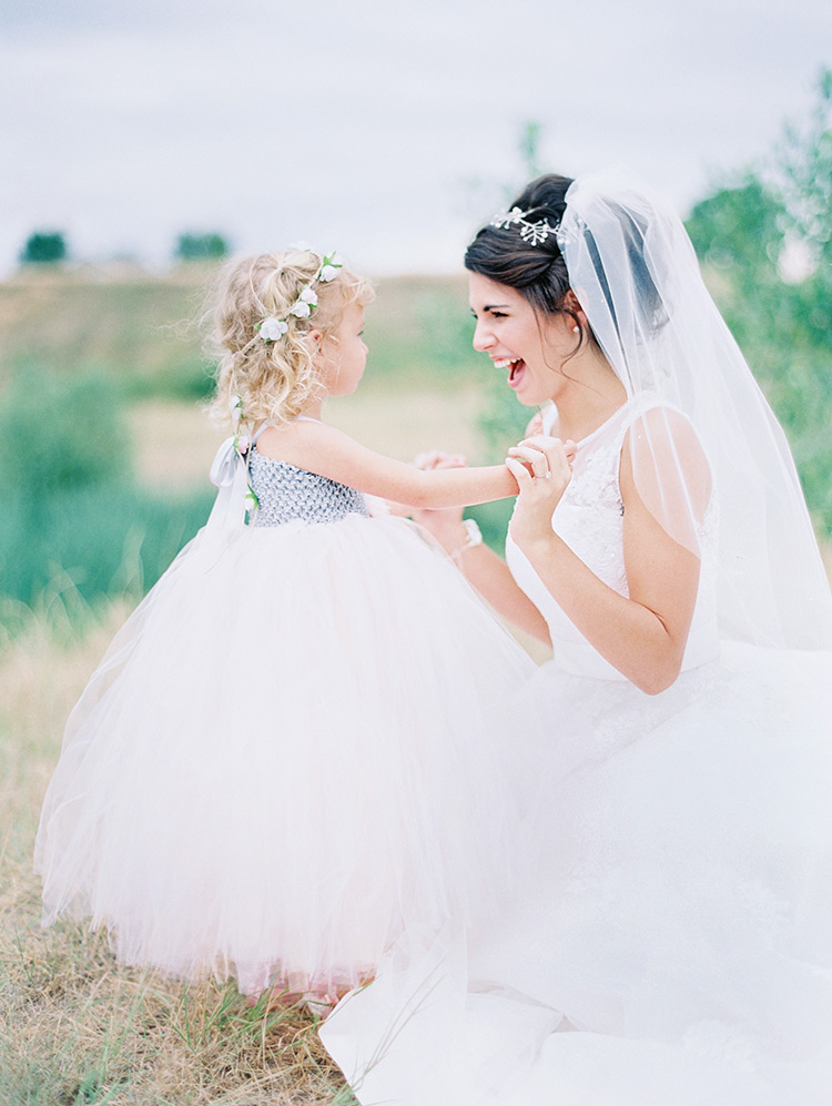 bride and flower girl on wedding day