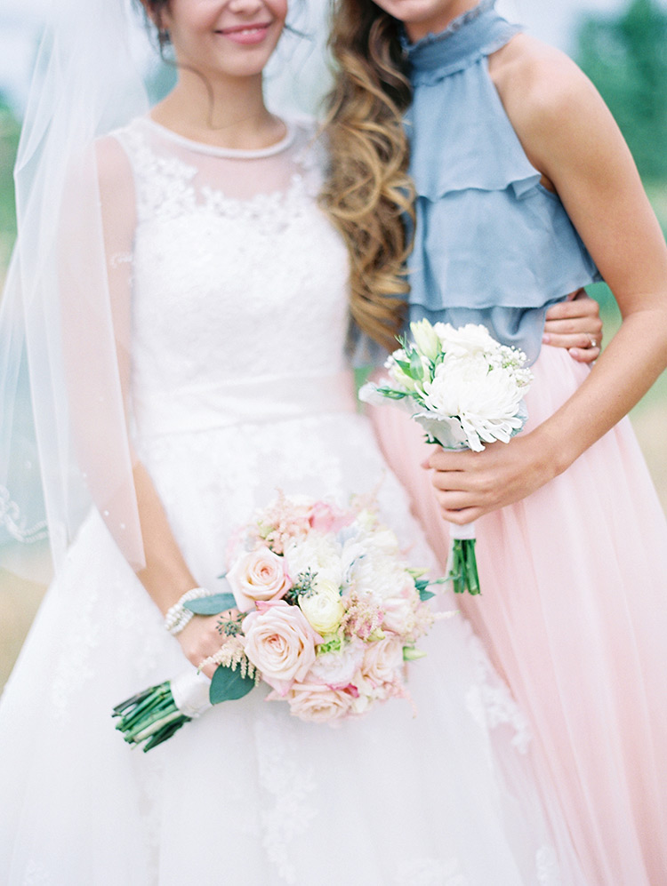 bride and bridesmaid light pink and yellow flower bouquets