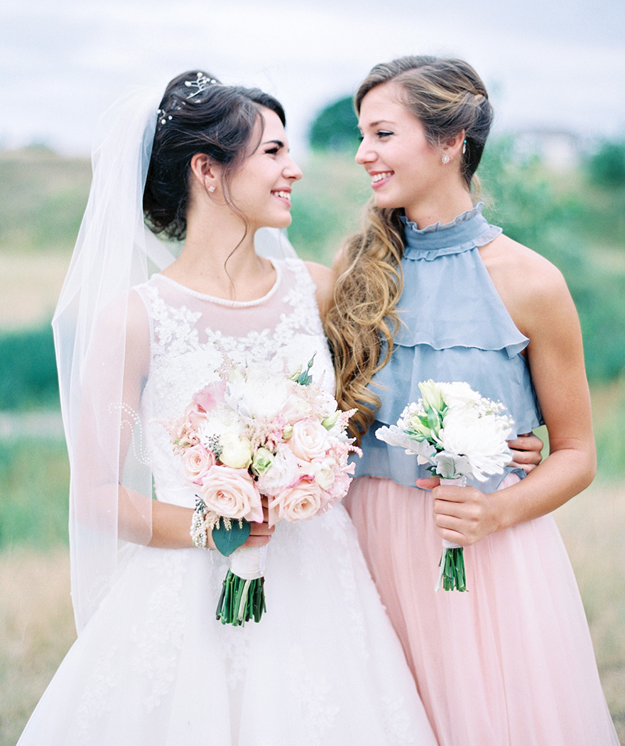 bride and maid of honor light pink, white, light blue color scheme
