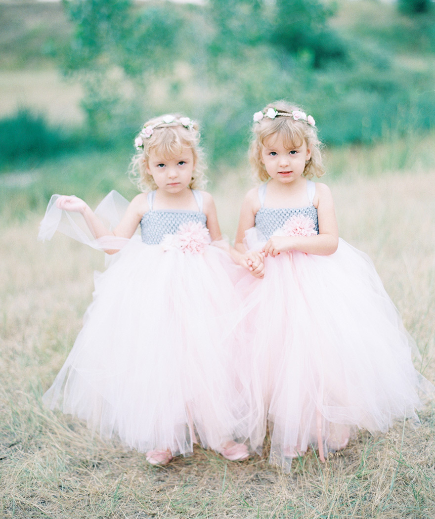 flower girls in light pink tulle dress with delicate flower crowns
