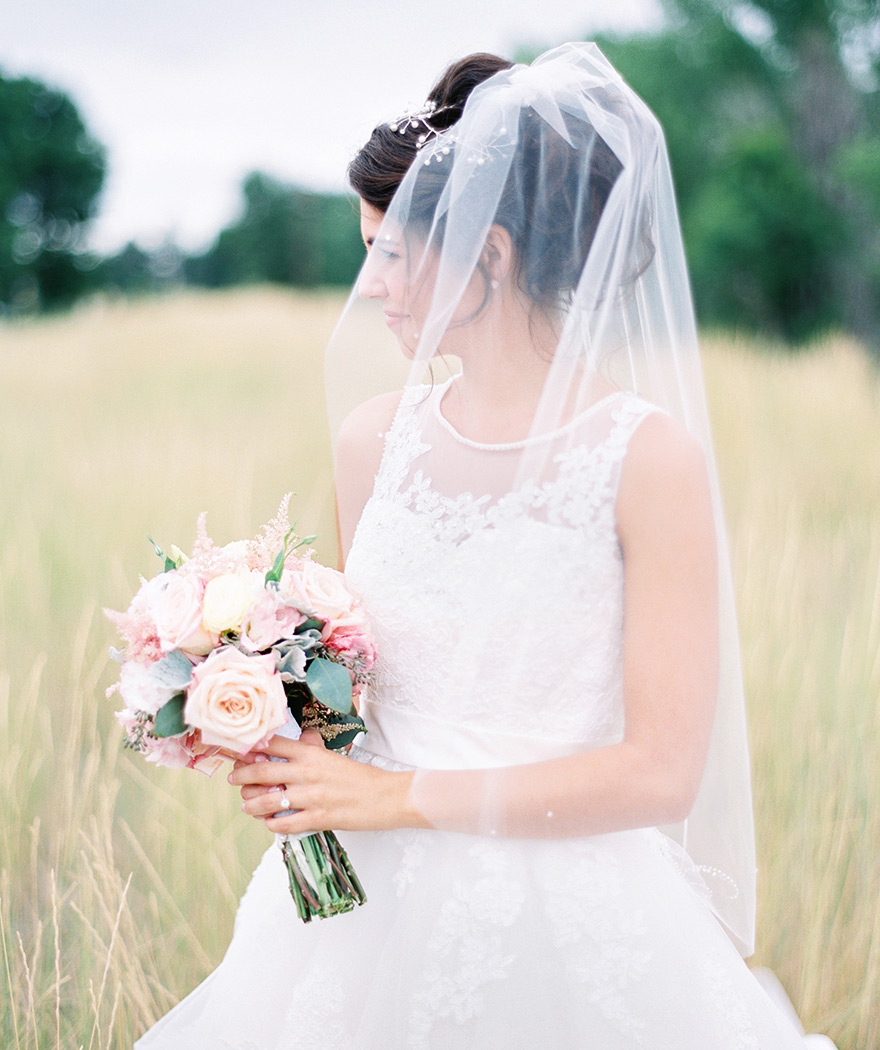 delicate lace wedding dress with beading and veil