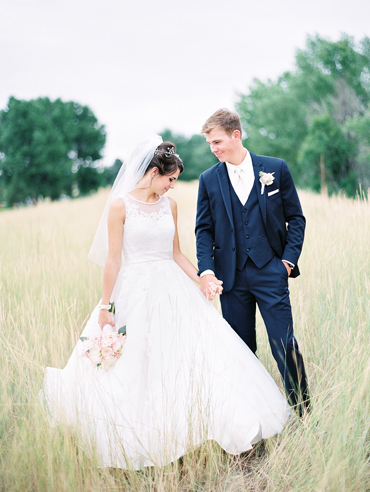 bride and groom first look in field of grass