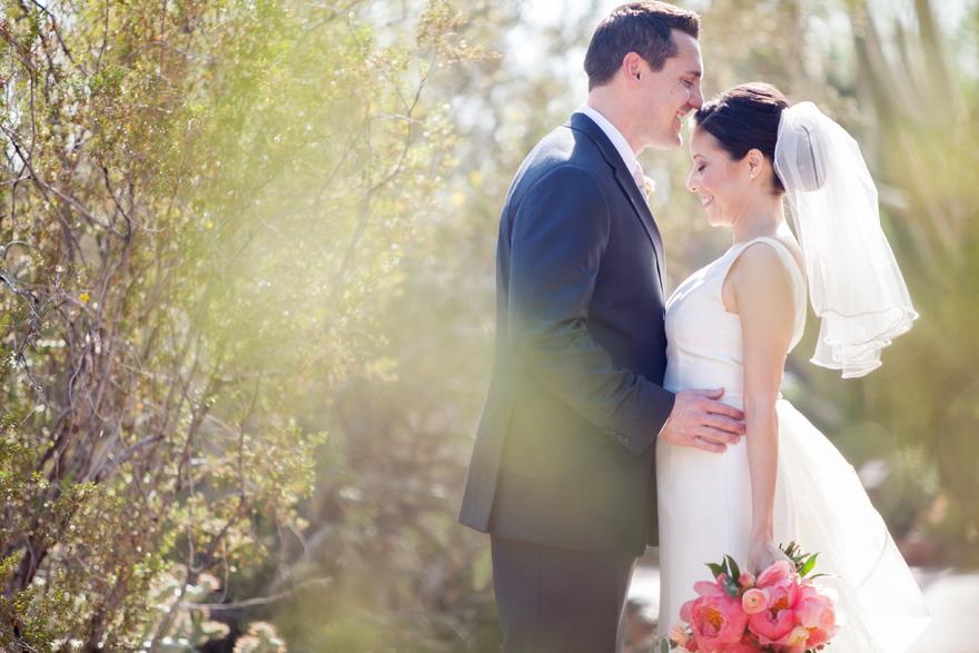 Joyful bride & groom share a moment on their wedding day.