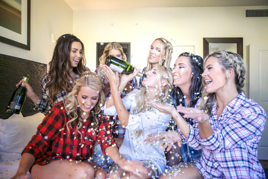 bridesmaids celebrate with confetti poppers