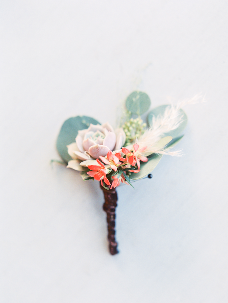 Creative boutonniere with succulents and eucalyptus.