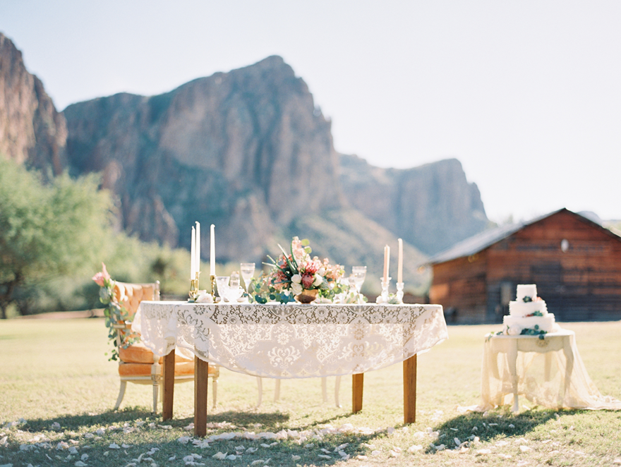 Eclectic vintage furniture with lace tablecloths for wedding inspiration. Boho wedding
