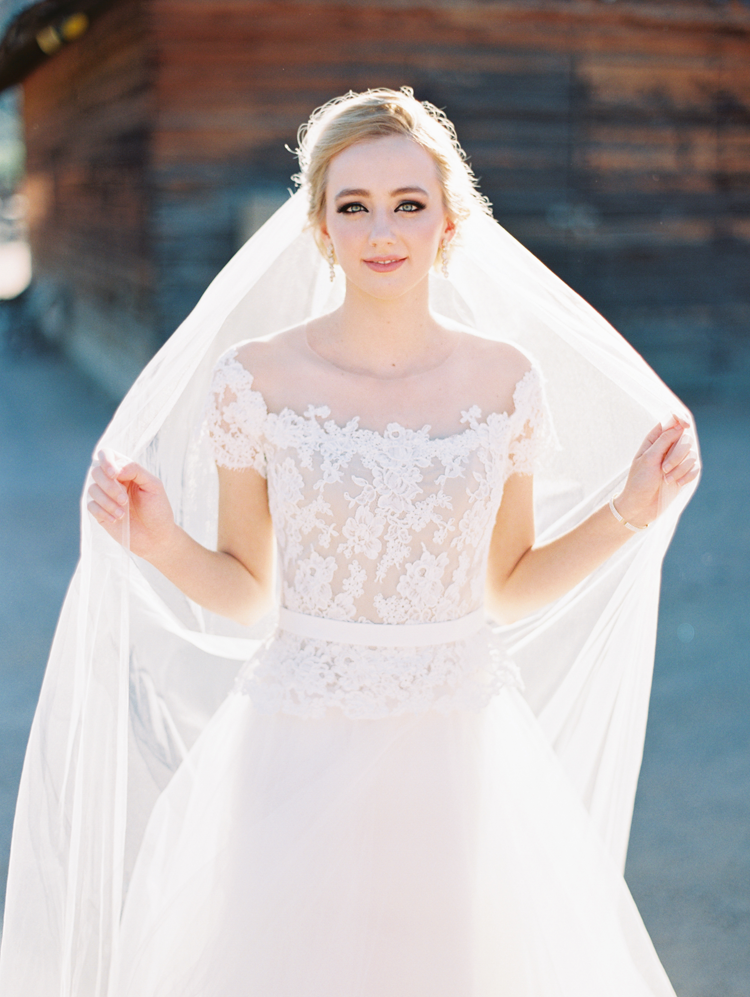 Dreamy bride in a pretty dress with a place and illusion bodice and soft tulle skirt