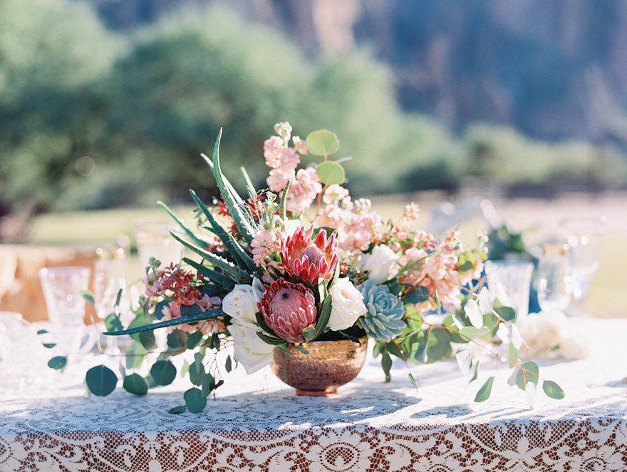 Wild and dramatic flowers for a wedding reception. Cacti, protea, succulents, roses.