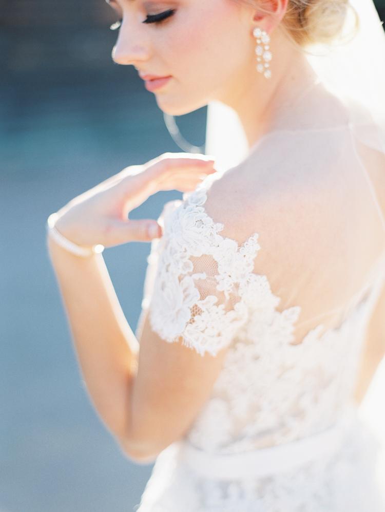 Illusion neckline on a lace dress makes the bride look like a fairy tale princess for her wedding