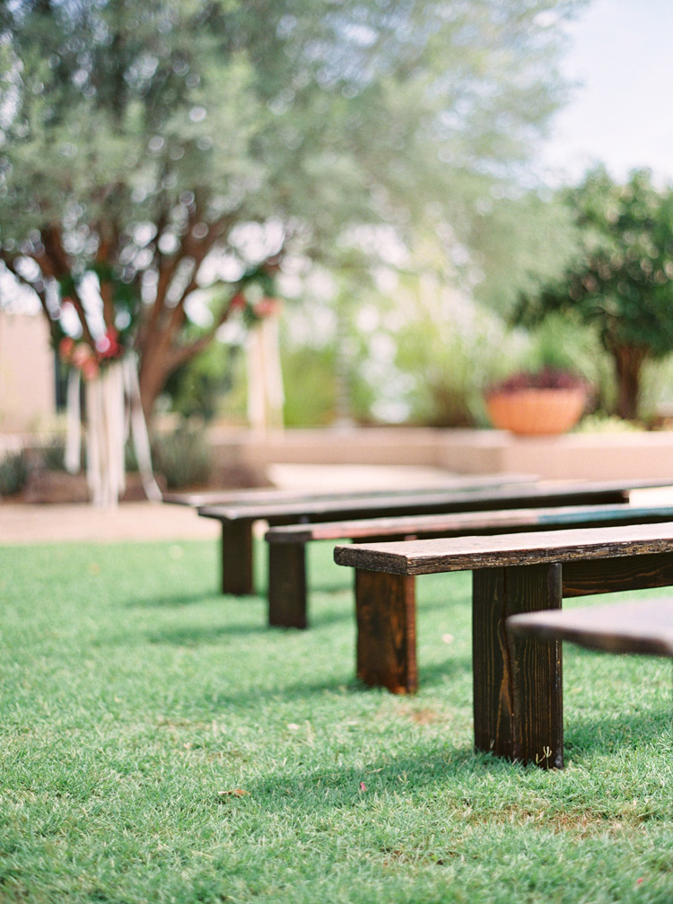 Benches on the grass for an outdoor wedding ceremony. Arizona wedding.