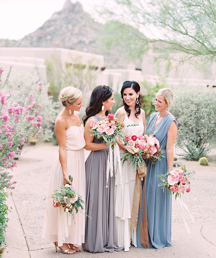 Bridal party in draped Paper Crown dresses designed by Lauren Conrad. Neutral color bridesmaids.