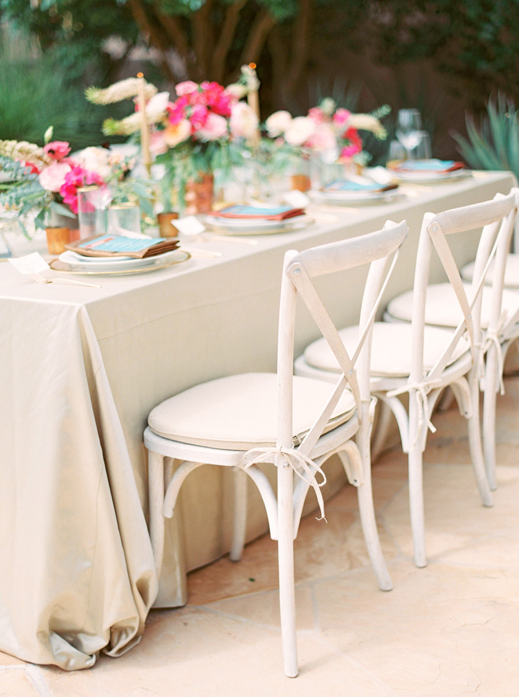 Outdoor reception table. Neutral linen, pink flowers, turquoise & copper accents. Arizona wedding.