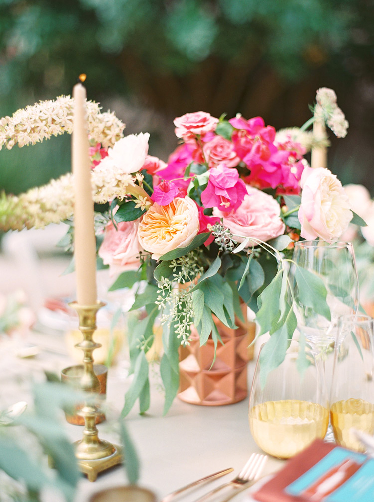 Outdoor reception table. Pink flowers, turquoise & copper accents.  Chic bohemian wedding.