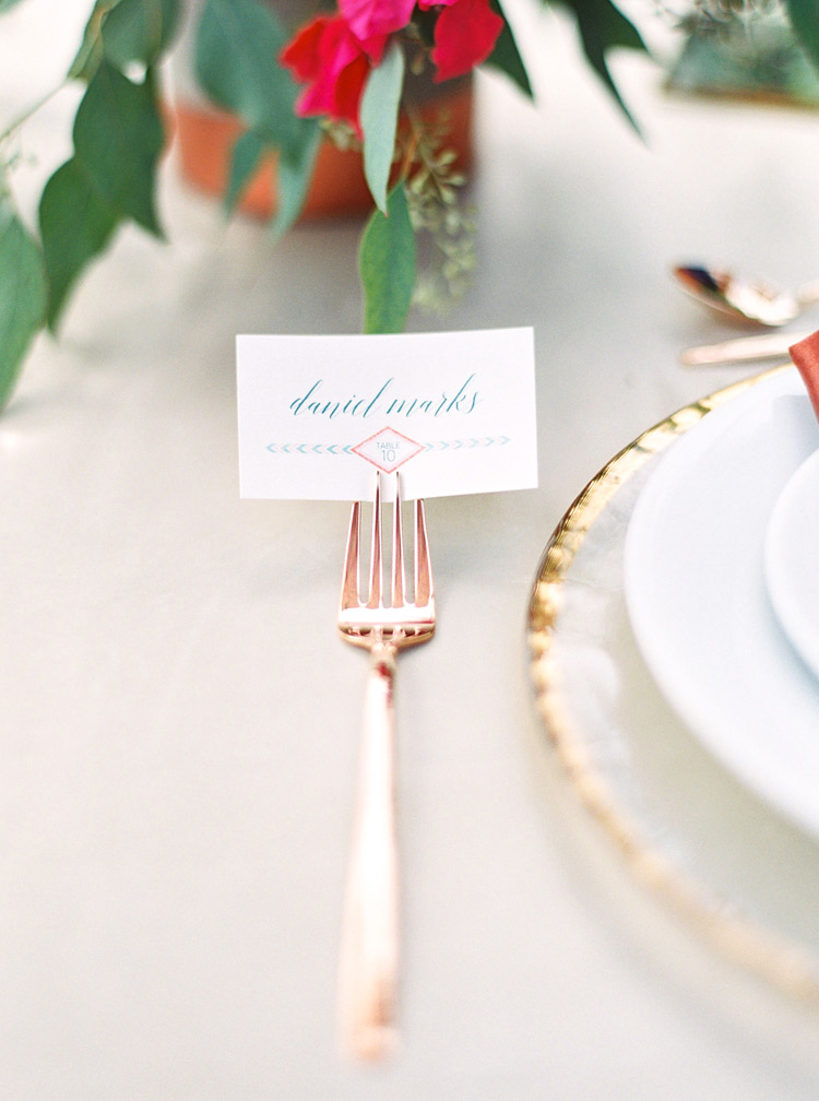 Modern Southwestern design. Elegant reception place card held in the tines of a fork.