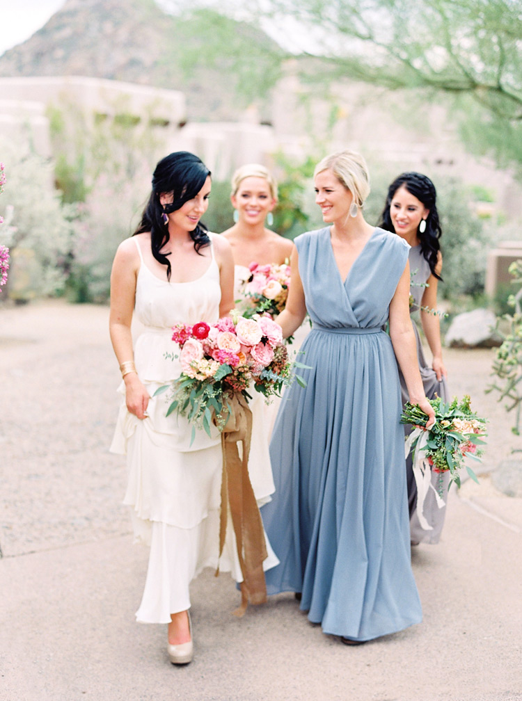 Chic, bohemian bridal party in an Arizona wedding. Neutral color bridesmaids with pink flowers.