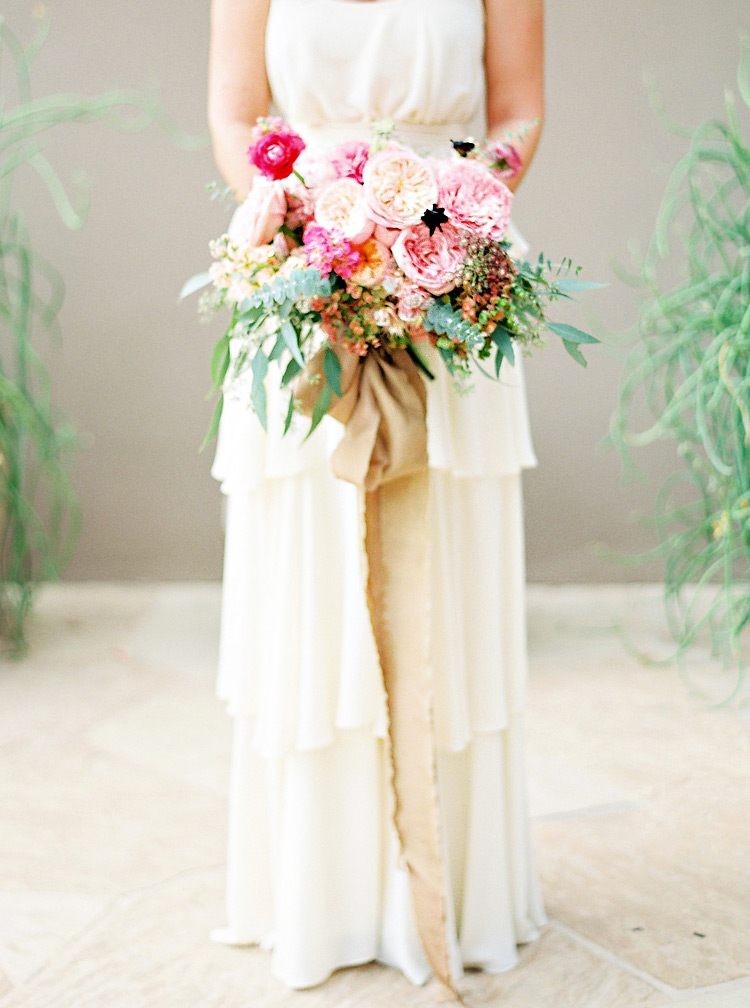 Paper Crown dress designed by Lauren Conrad for a chic bride. Rich pink bouquet w/ silk ribbons.