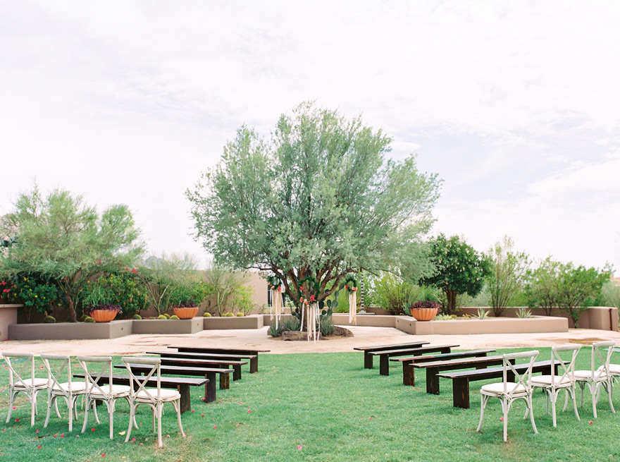 Outdoor wedding ceremony. Modern Southwestern Arizona wedding with hanging wreaths.