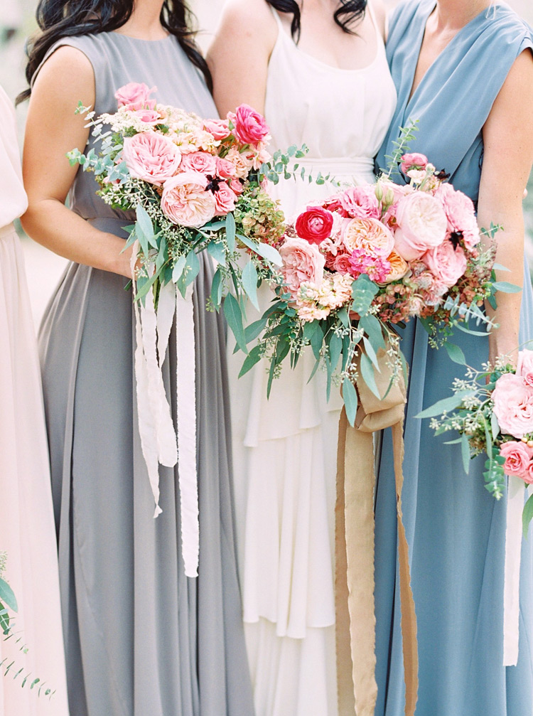 Bridesmaids in neutral color draped dresses. Pink bouquets inspired by the sunset. Chic bohemian