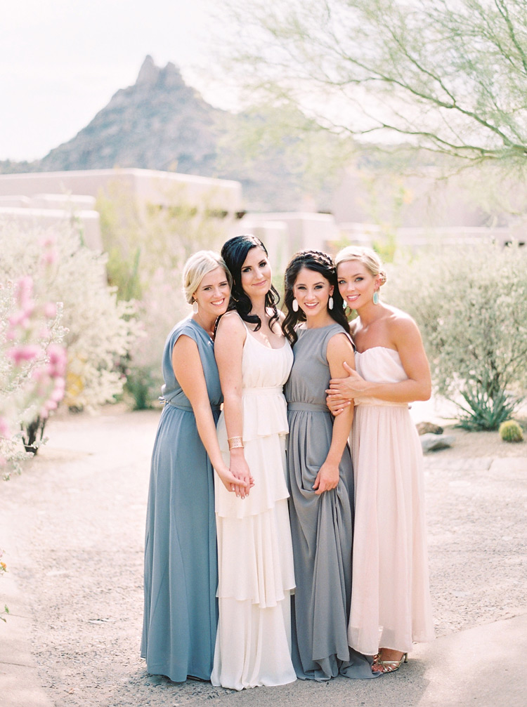 Chic, bohemian bridal party. Neutral color bridesmaids in draped dresses from Paper Crown.