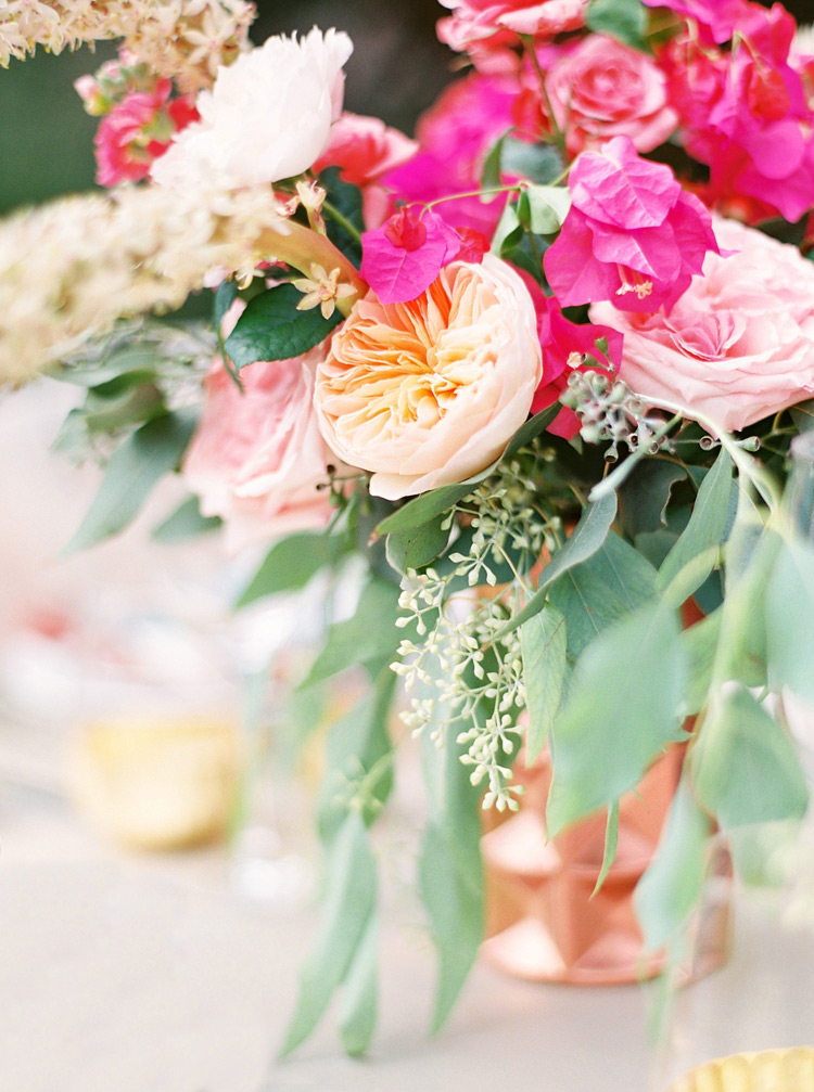 Loose & organic floral design of pink flowers in a copper vase. Chic & modern Southwestern wedding