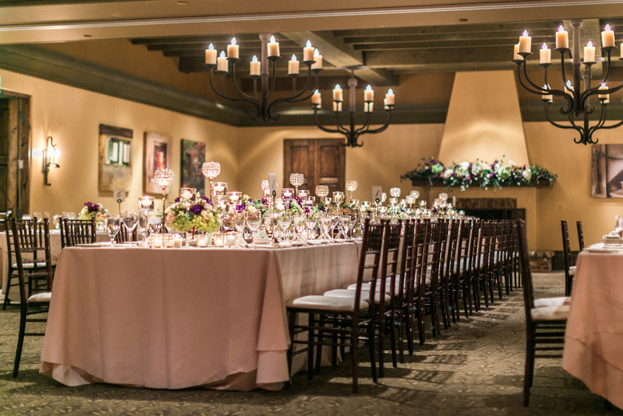 Indoor Wedding Reception Table Set Up With Blush Cloth And Dark Wood Chairs