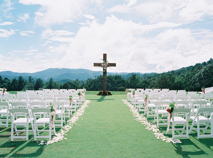wooden cross at an outdoor wedding ceremony in the mountains of North Carolina