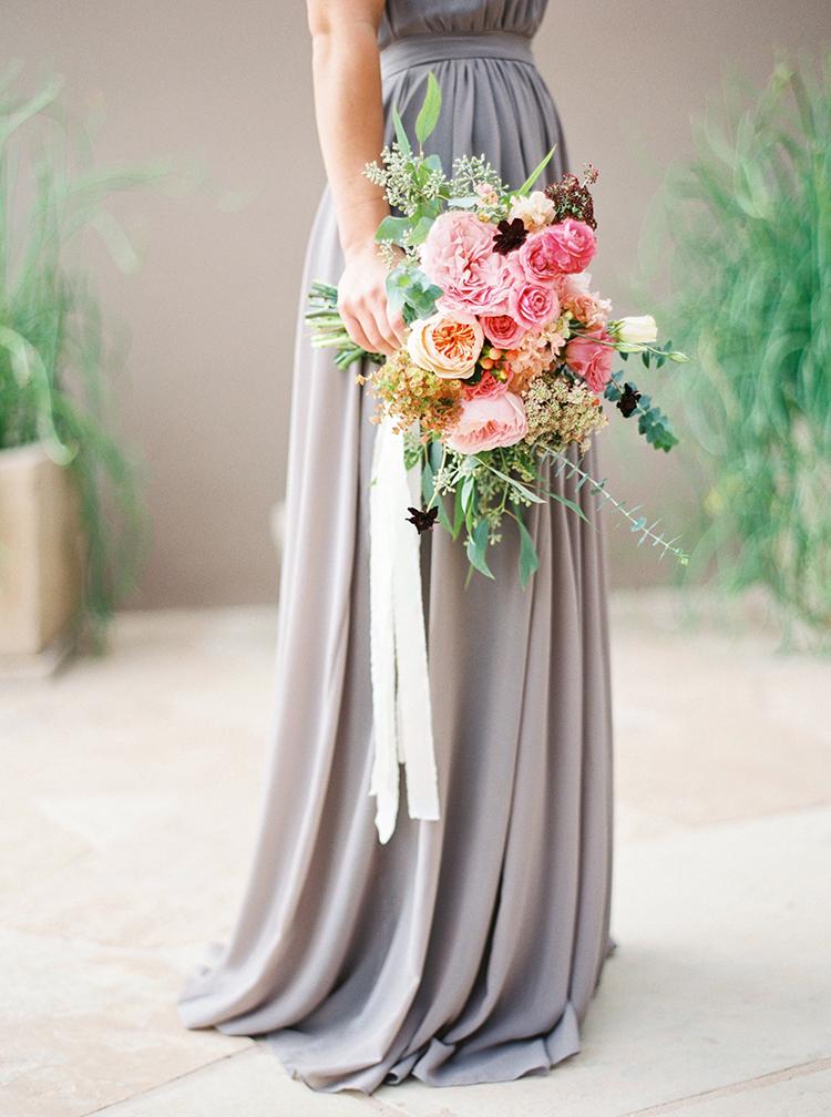 Bridesmaid Holds Pastel Natural Bouquet Arrangement Outdoors