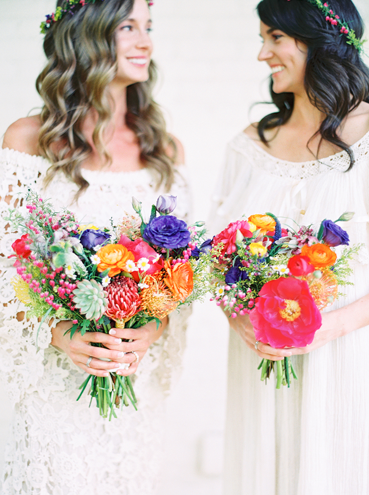 Boho bride & bridesmaid with vibrant floral bouquets