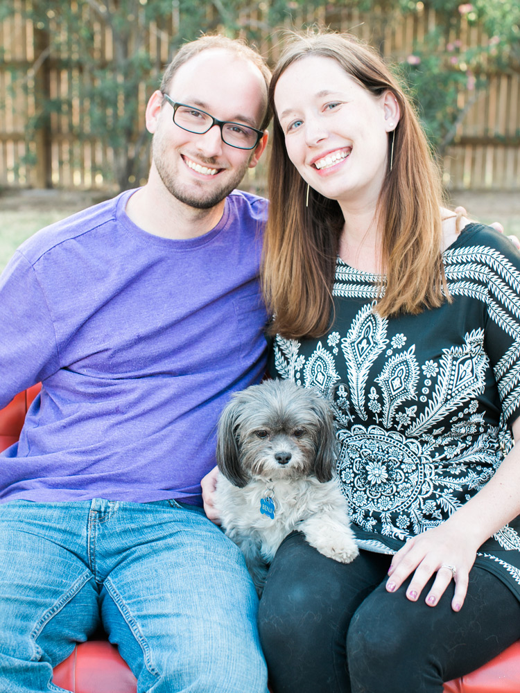Happy couple with puppy. Outdoor fun.