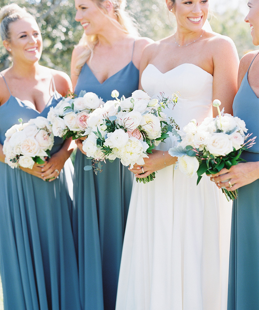 bridesmaids in blue with white & blush flowers