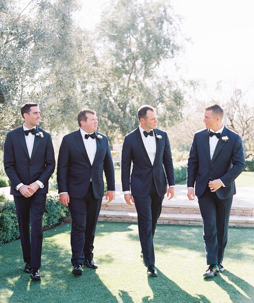 groomsmen in classic tuxedos
