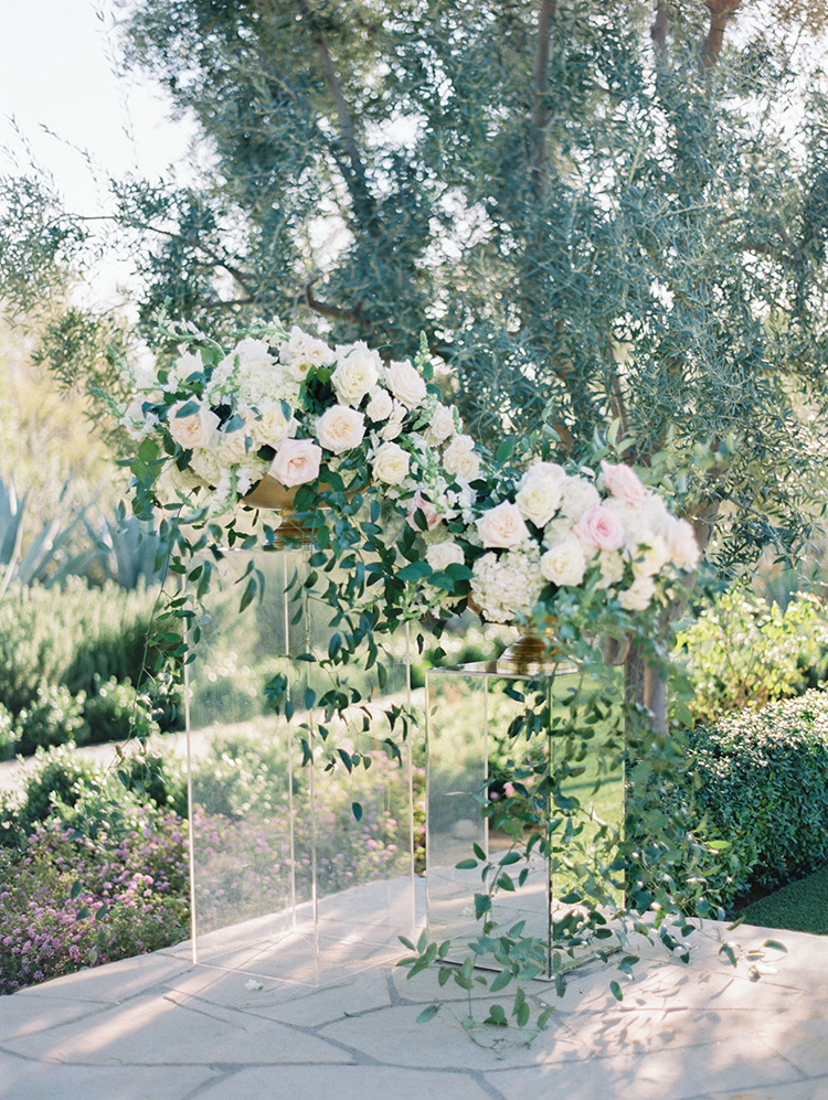wedding flowers in white & blush on clear columns