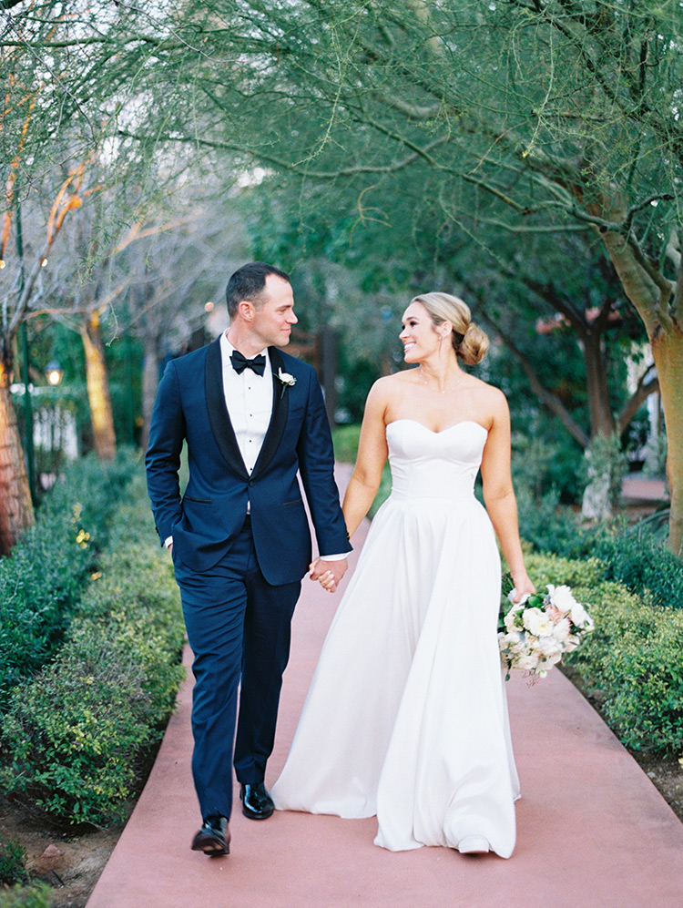 deep blue tuxedo and classic white wedding gown