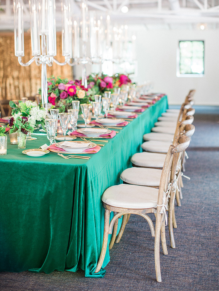 lush, green tablecloth and modern glass candelabra