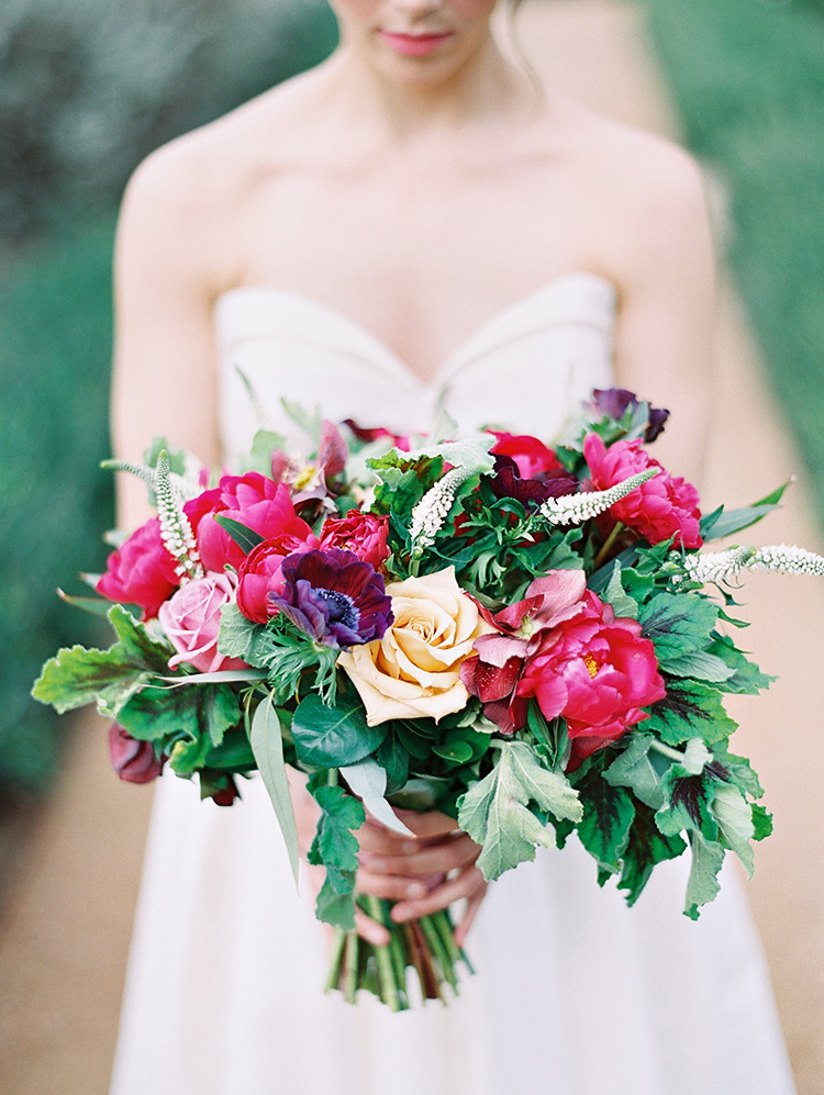 bouquet full of greenery and burgundy & yellow flowers
