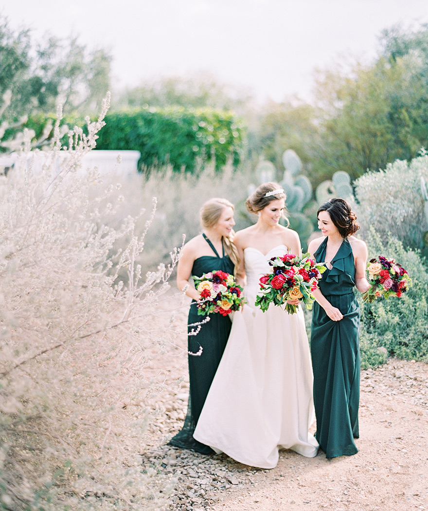 bridesmaids in emerald laugh with the bride at El Chorro in Arizona