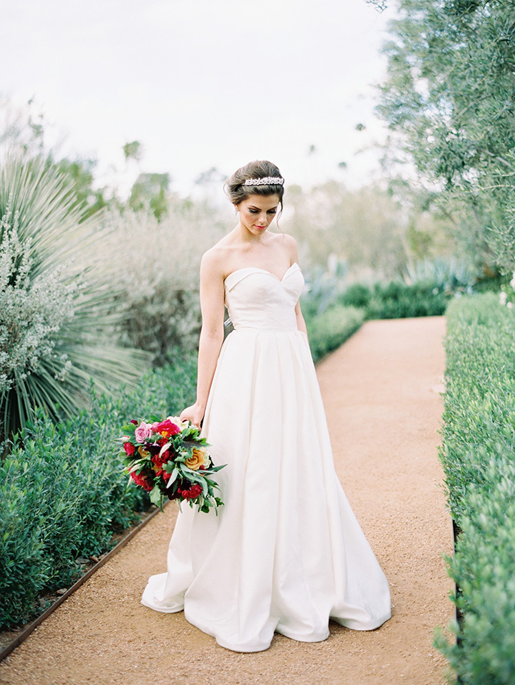 strapless ballgown with a pleated skirt from Kelly Faetanini, burgundy bouquet