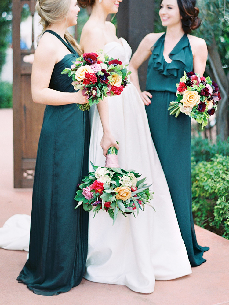 strapless Kelly Faetanini wedding dress, emerald bridesmaids with burgundy & yellow bouquets