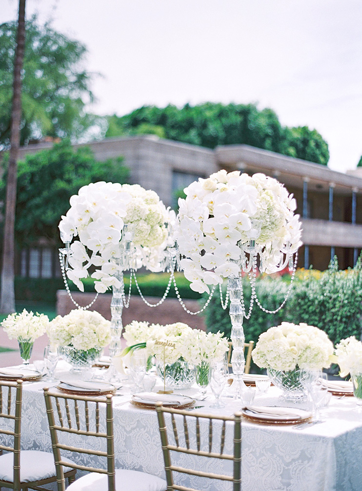 elegant outdoor reception with white flowers & crystals