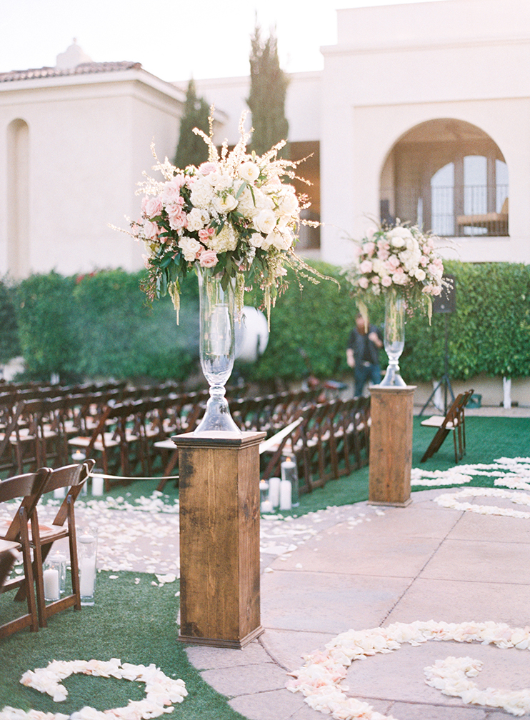 outdoor wedding ceremony full of flowers