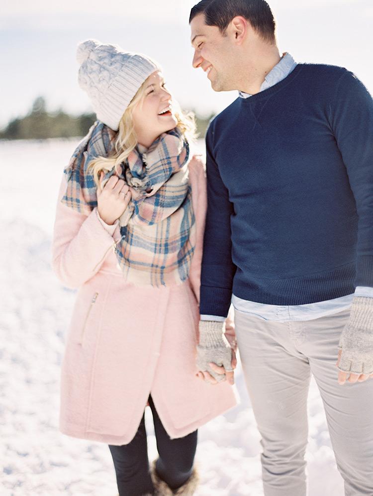 pink coat, plaid blanket scarf