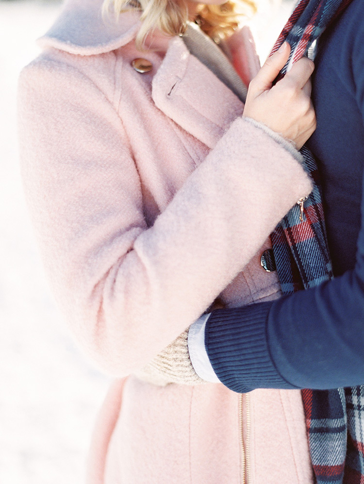 pink winter coat on her; scarf on him