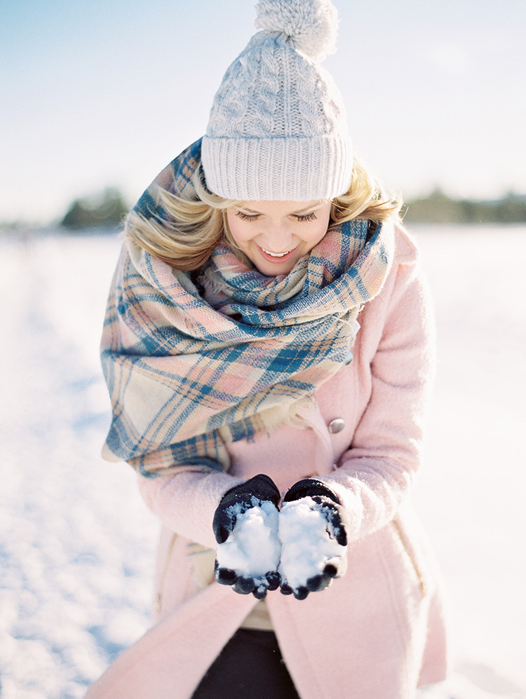 pink winter coat and plaid blanket scarf