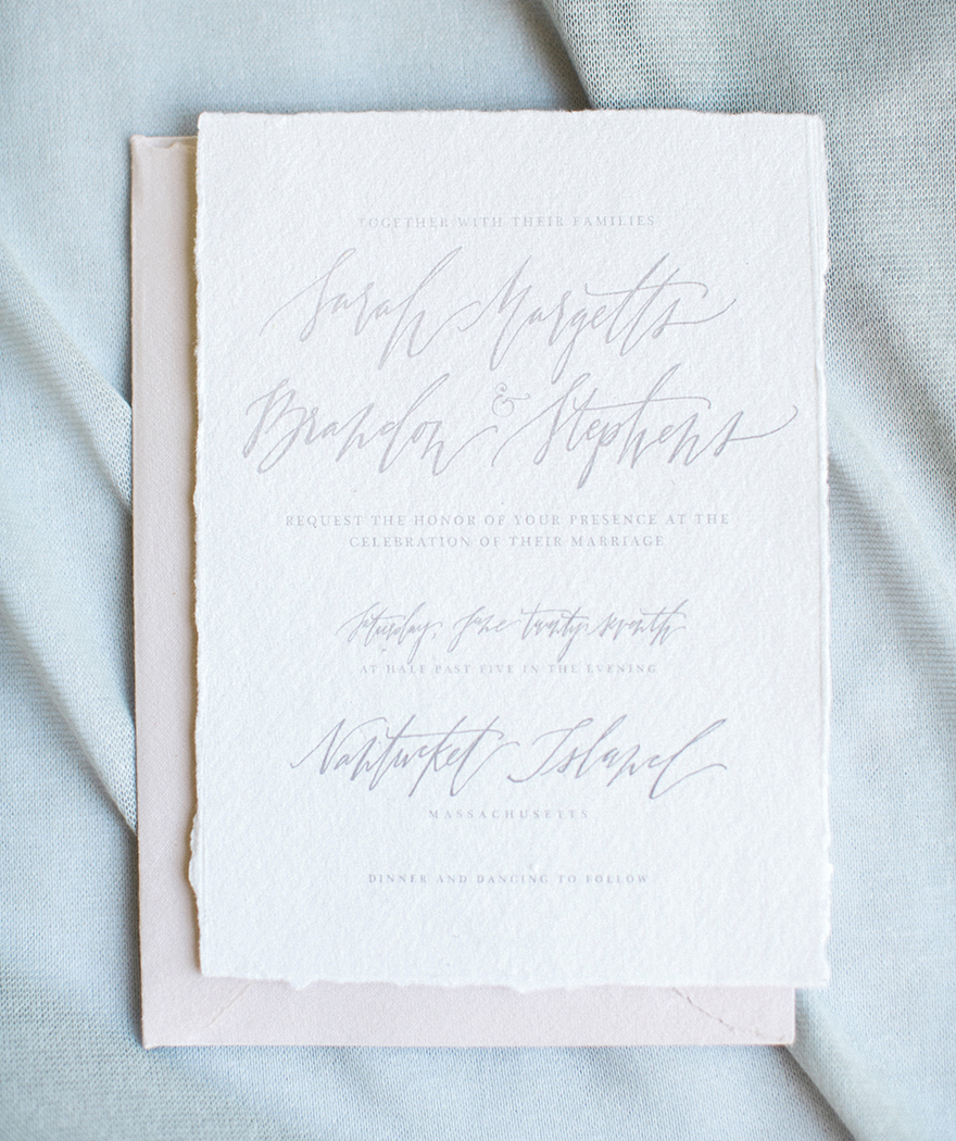 Wedding invitations with handmade papers, custom calligraphy, and a neutral palette