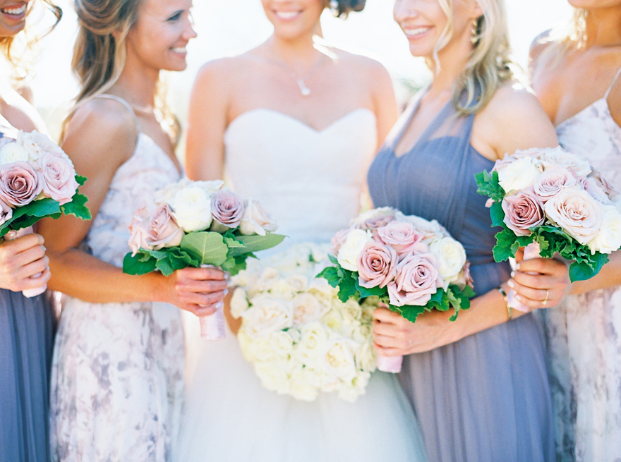 bridesmaids in lavender and floral print dresses