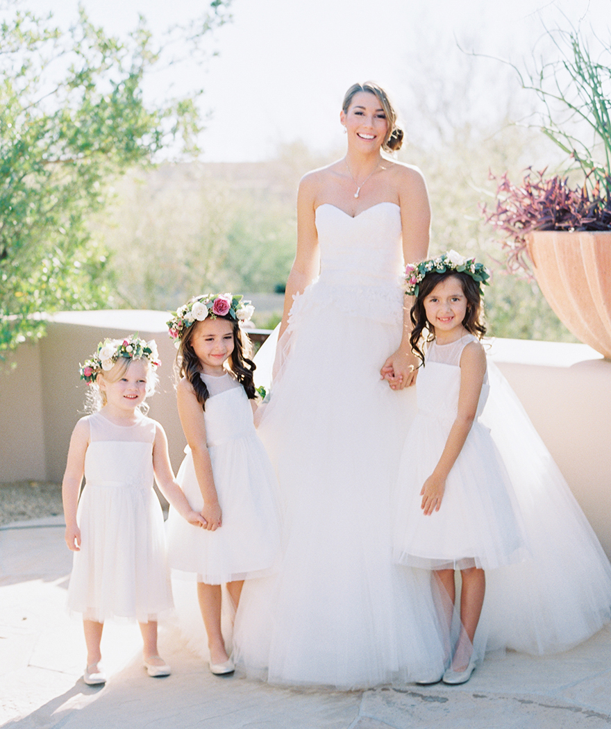 love these flower girls wearing flower crowns!