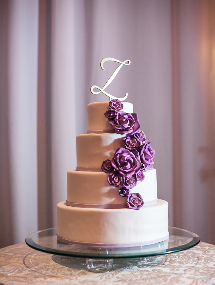 Wedding cake with cascading purple sugar flowers