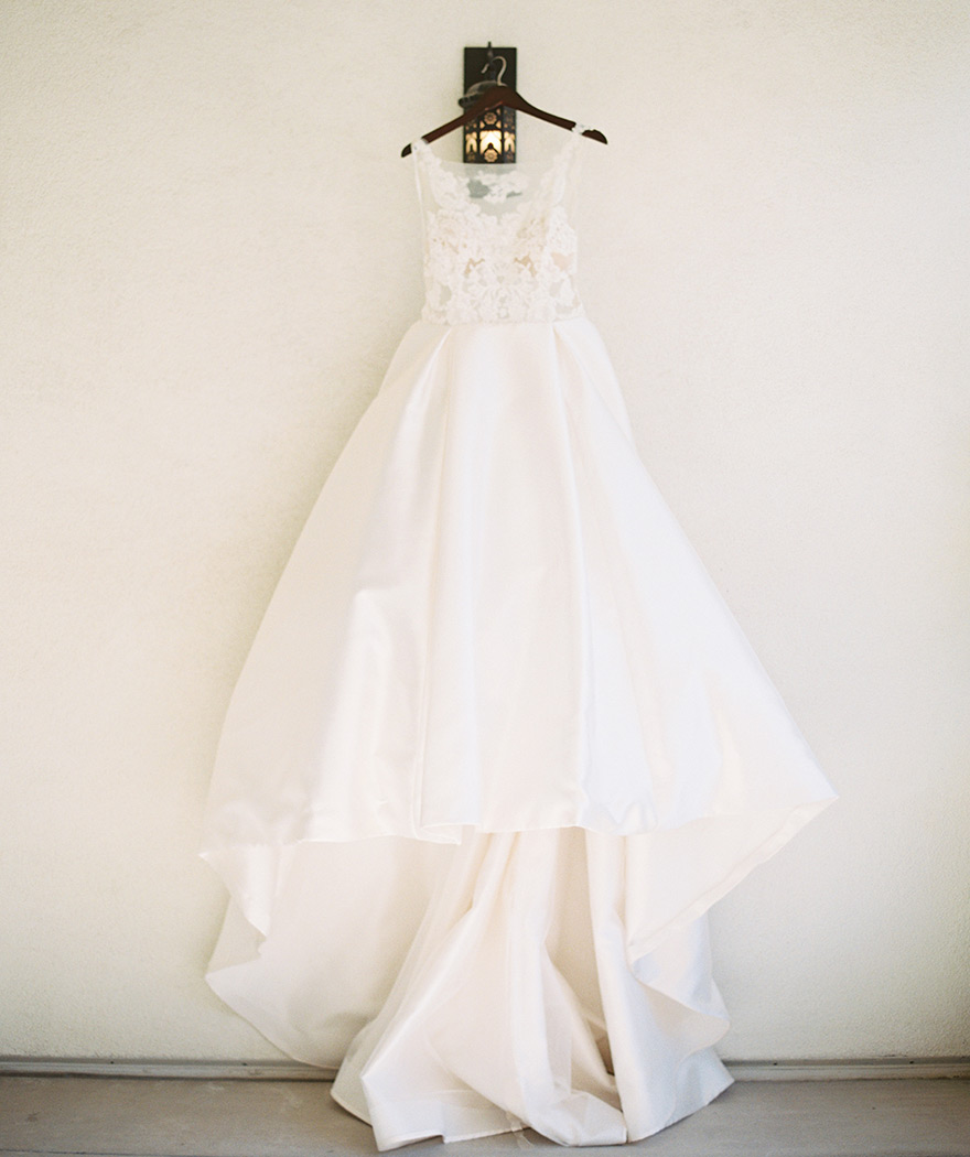 wedding dress of satin, illusion, and lace by Lazaro