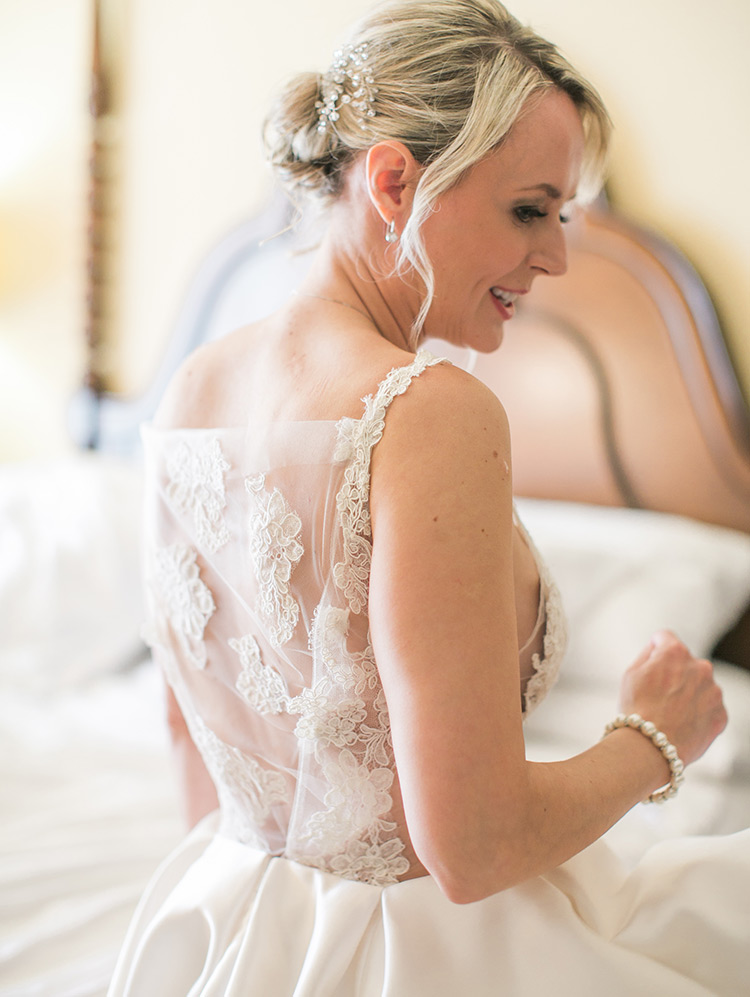 wedding dress of satin, illusion, and lace