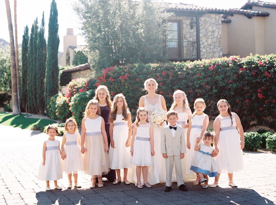 bride with her 10 flower girls